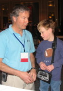 Mike showing BrailleNote GPS Jacob Gross, age 6 - one of Sendero's youngest GPS users, at CTEVH 2006