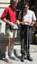Mike showing BrailleNote GPS to a curious blind bypasser