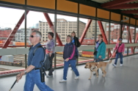 Group of blind travelers navigating through Vancouver, BC