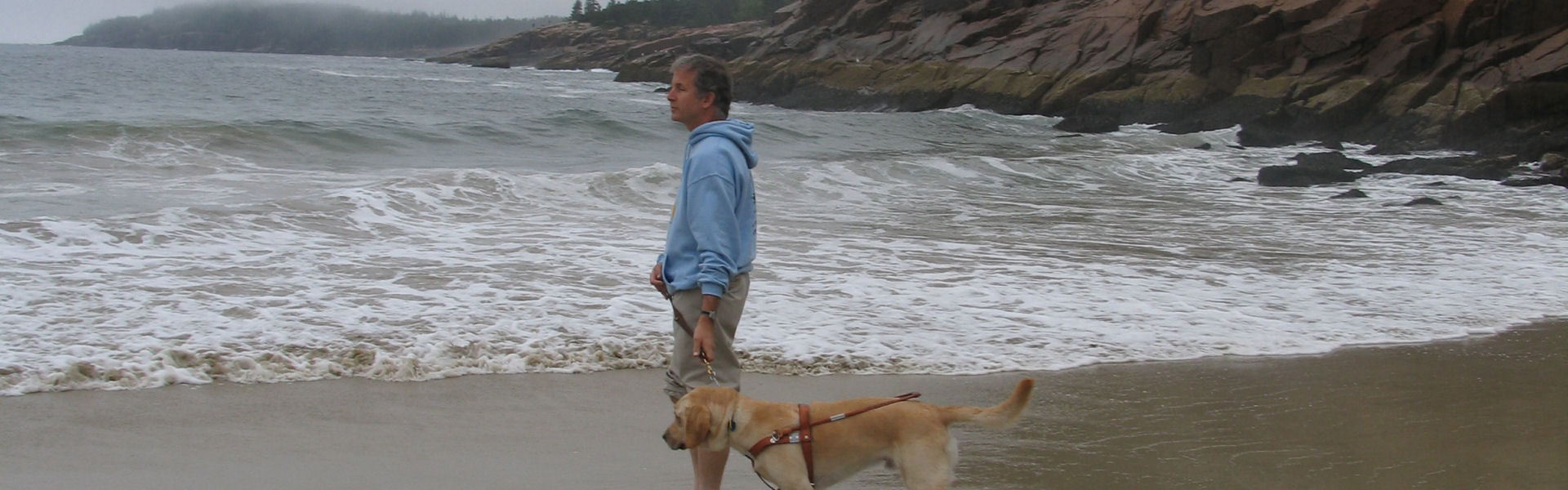 Mike and Seeing Eye dog, Miguel, at a Maine beach